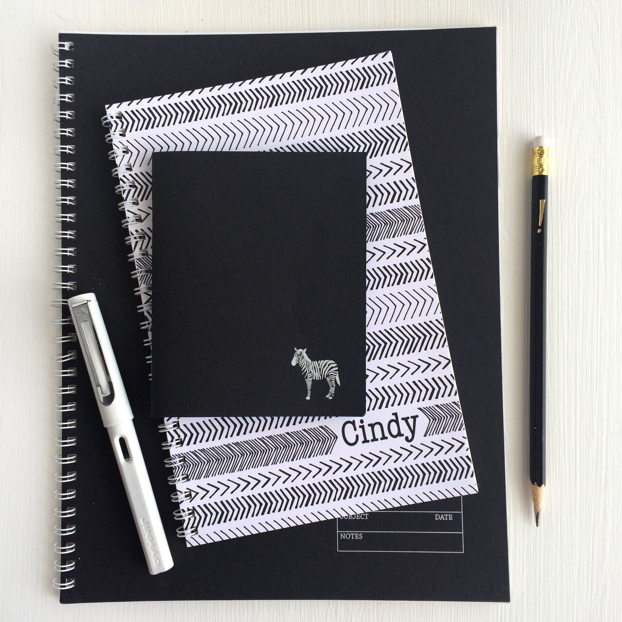 black and white notebooks with a little bit of whimsy